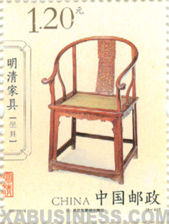 Pear wood armchair, decorated with cravied hornless dragon medallions (Ming Dynasty)